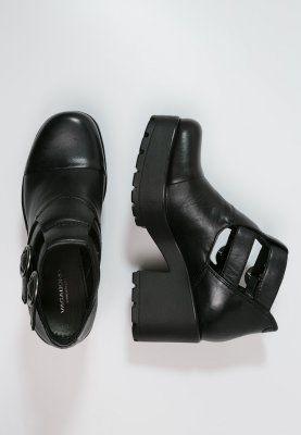 bottines noir à talons et à ouverture sur les côtés ☆