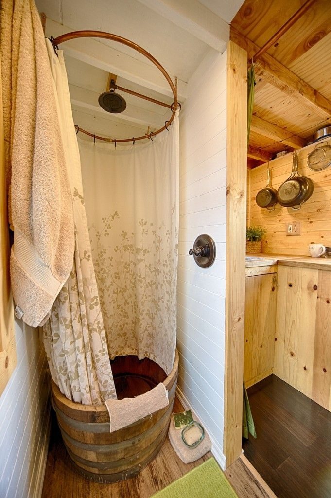 shower space made from recycled wooden barrel