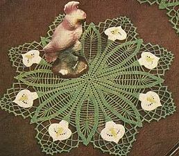 Calla Lily Buffet Set Doily - I'm not sure if my mother or my aunt (or both) made these, but I've got a whole set of them.  They've got to be around 60 years old and are getting fragile - I'll have to try my hand at reproducing them now that I have the pattern.