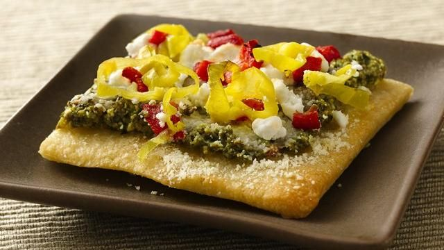 Refrigerated pizza crust makes quick work of home-baked appetizers topped with delicious Mediterranean ingredients.