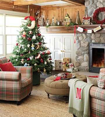 Love the stone fireplace the plaid furniture, and the rustic feel of this room.