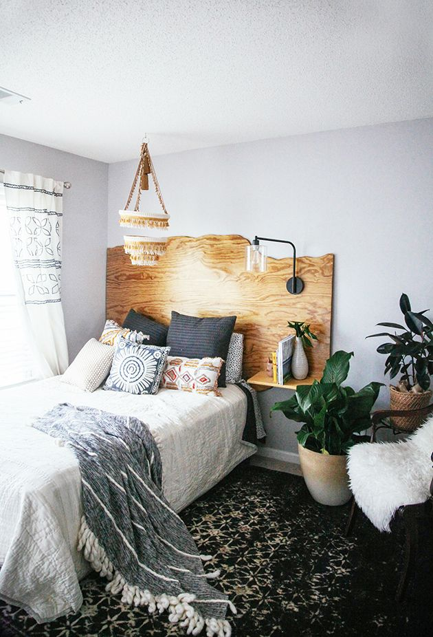 "I love the textures, and the idea of a ""headboard"" with a night stand and lamp attached."