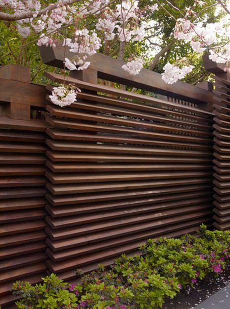 Horizontal slat fence stained dark