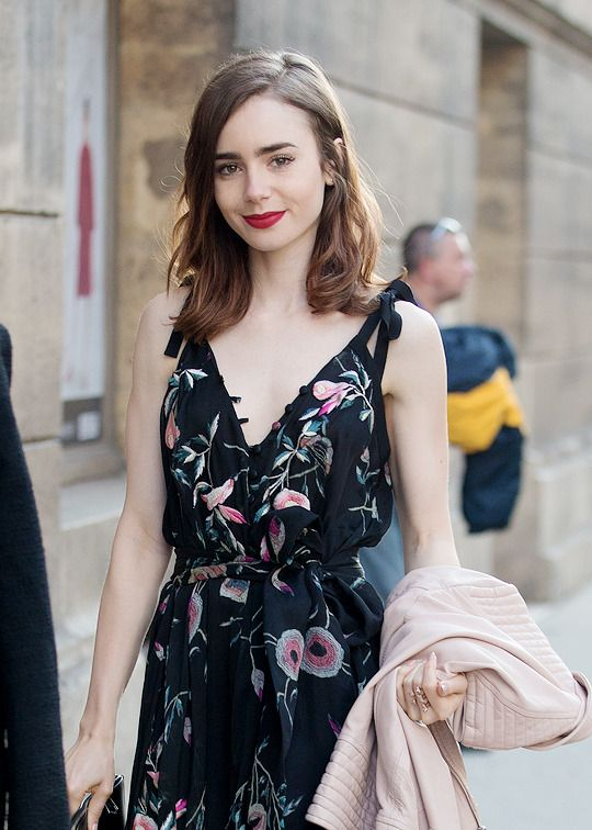 Lily Collins at the restaurant Loulou in Paris, France on July 2, 2017.