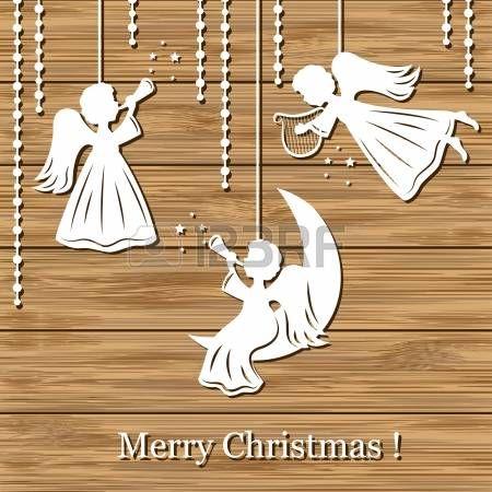 Vánoční pozadí s anděly řez papíru na dřevo