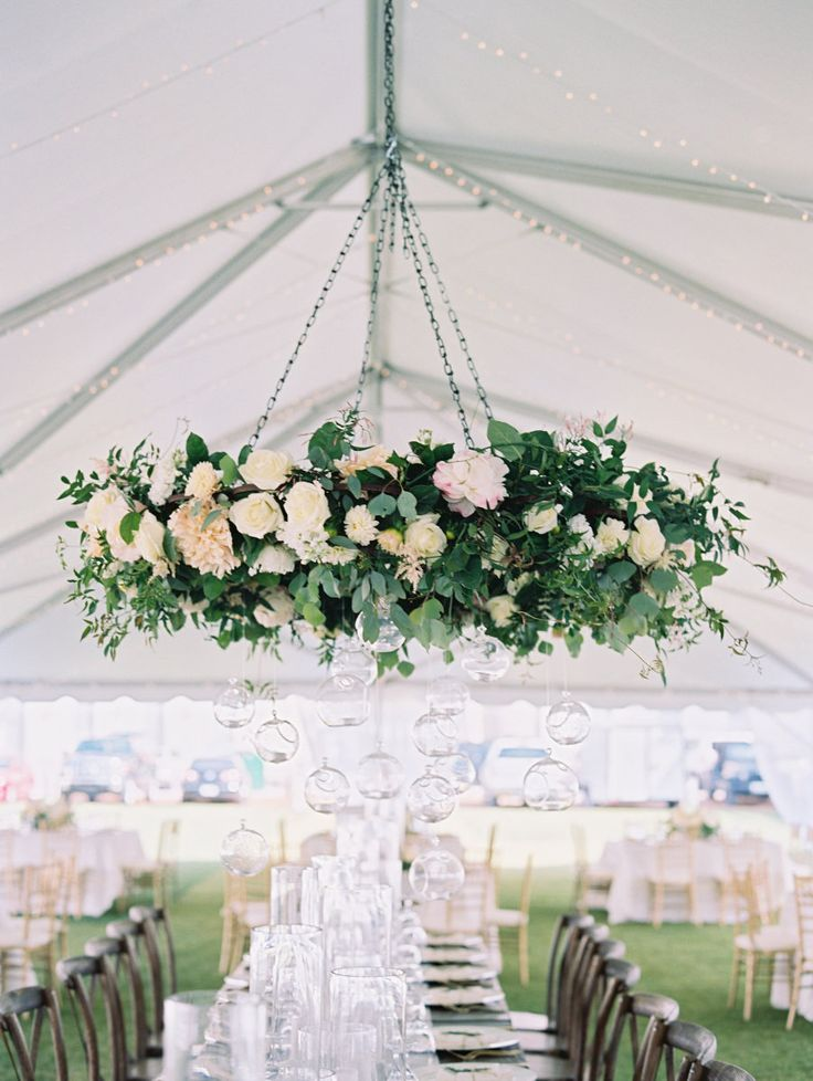 Elegant fresh floral chandelier: Photography : Lauren Kinsey Read More on SMP: http://www.stylemepretty.com/2016/07/21/seaside-florida-little-white-chapel-wedding/