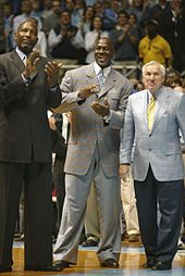 James Worthy, Jordan, and Dean Smith at a University of North Carolina game honoring the 1957 and 1982 men's basketball teams.