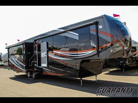2016 Lifestyle Luxury RV 38RS Fifth Wheel Video Tour • Guaranty.com - Published on May 21, 2015 If you're on the lookout for a luxury fifth wheel that would be perfect for either summer RVing or a more long-term RV lifestyle, be sure to take a look at this 2016 Lifestyle Luxury RV 38RS on our website. You can see our entire inventory of fifth wheels at http://www.guaranty.com/find/rvs/fift....  At 39' and with three slide-outs, this fifth wheel will give you all the luxurious amenities you…