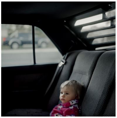 "This photograph is apart of Raphaela Rosella's series ""You didn't take away my future. You gave me a new one"". I like how with this series there is a common theme of cars in some of the images which helps make it a cohesive piece of work. I also think that you could not have had the series about the teen mums without having included a kid in the photo. There is also some kind of isolation about this photo which I do quite like and feel it sits well with the meaning."