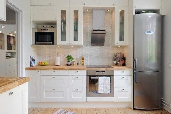 wysokie - zabudowa do sufitu -białe szafki kuchenne