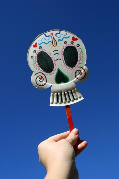 scrumdilly-do!: Make Paper Plate Calaveras Masks! - Once you get the hang of it, super easy and thru look cool. Kids loved it.