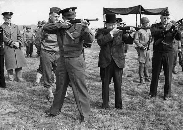 Major General Edward Brooks demonstrating M1 Carbines to Dwight Eisenhower Winston Churchill and Omar Bradley England United Kingdom 15 May 1944.