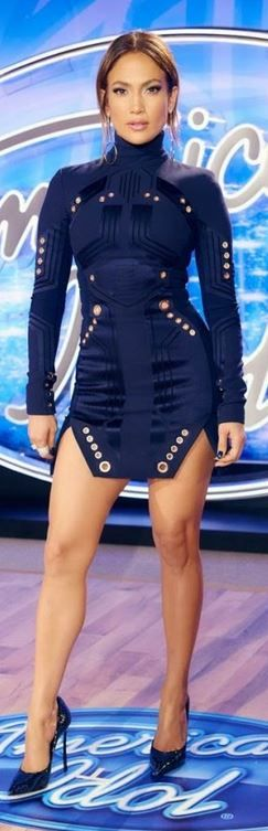 Who made Jennifer Lopez's blue long sleeve dress and pumps?
