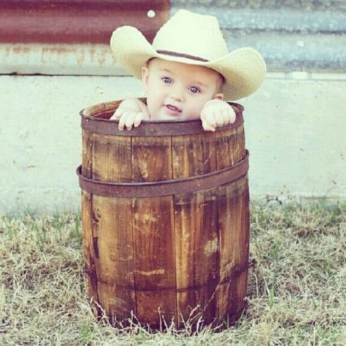 I am SO taking this pic with the baby - once he is older. This is too cute. A little cowboy love. Great baby photography idea/toddler too
