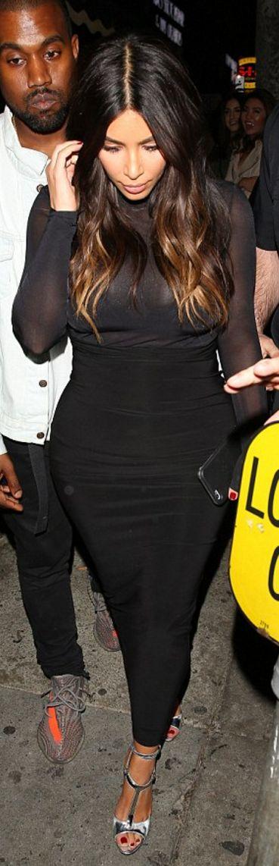 Who made  Kim Kardashian's black skirt, mesh long sleeve top, and silver sandals?