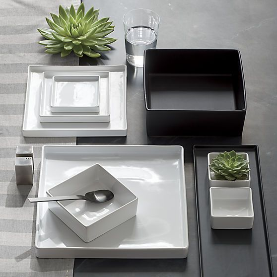 Go-to, go with everything dinnerware turns a corner in smart white stoneware. Raised rims square off interactive plates. Deep square bowls think outside the box.
