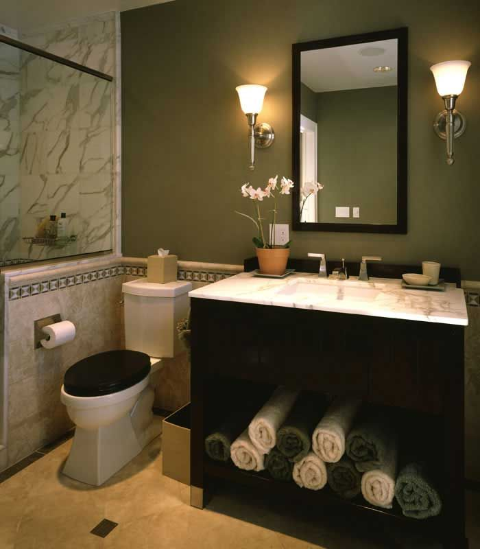 elegant powder room with black vanity marble tile sage green walls