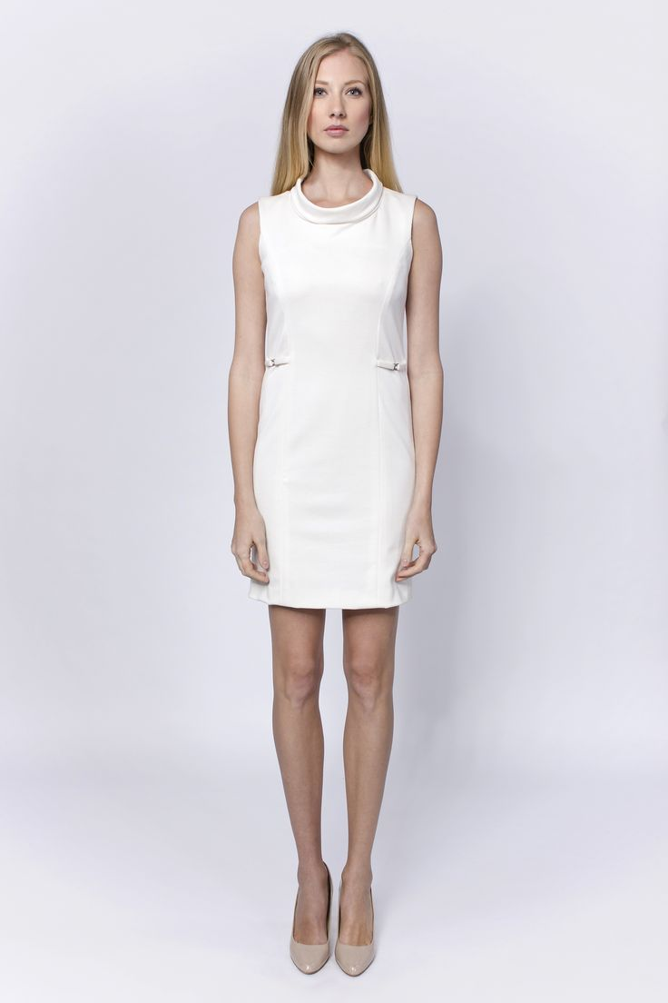 Cream dress with embellishments on th sides for the fans of sleek chic style.
