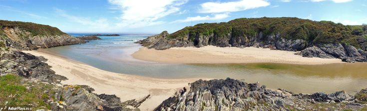 La Paloma or Esteiro beach in Tapia de Casariego, Asturias, Spain - panoramic view of the beach and the Esteiro river flowing here into the sea.