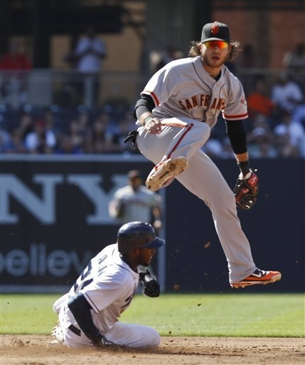 San Francisco Giants shortstop Brandon Crawford hurdles San Diego Padres' Cameron Maybin while relaying to first to complete a double play in the third inning of a baseball game Wednesday, June 6, 2012 in San Diego.