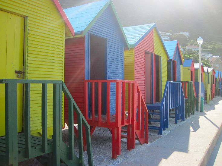 Beach huts at St James Beach, a popular spot for families as it has it's own tidal pool — at Boulders Beach, Cape Town, South Africa