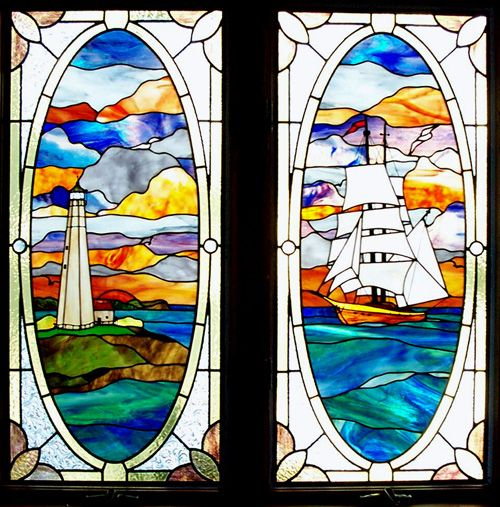 View of Eatons Neck light house and matching tall ship stained glass panel set.  Andersen casement window inserts.