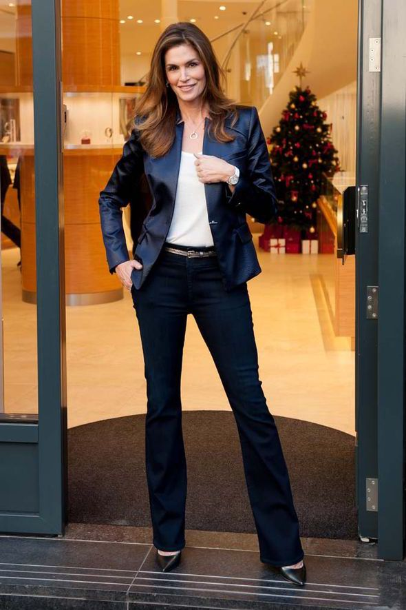 Cindy Crawford turns heads in skinny jeans as she opens OMEGA shop