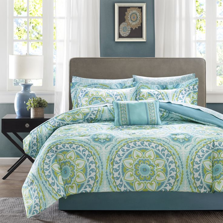 For a modern update to your space, the Madison Park Essentials Orissa Complete Bed and Sheet Set can provide a whole new look with fun colors.