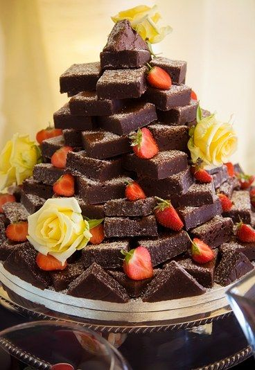 Brownie wedding cake  - 20 amazing alternative wedding cake ideas - Is there ever a time not to have a chocolate brownie? Exactly. A chocolate brownie wedding cake just makes so much sense; we don't quite know why no one thought about this before...