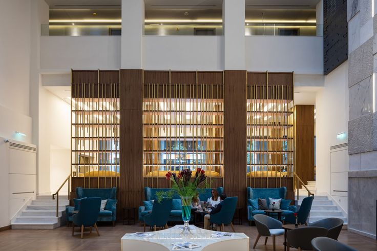 A bar lounge under a unique sky-light Atrium at the center of the hotel. Atrium is a meeting place where you can enjoy a refreshment, a drink from its expert curated selection or a light snack.