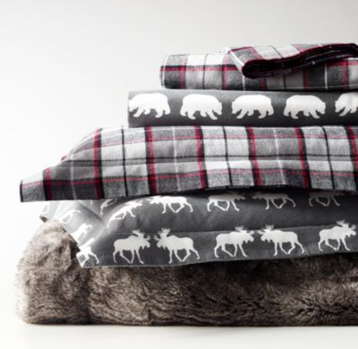 RH Baby & Child's Lodge Plaid Flannel & Moose Flannel Bedding Collection:At once new, yet enduringly classic, our plaid flannel bedding enlivens the room with the spirit of winter. Woven in Portugal of pure cotton, the palette of grey and red threads puts a contemporary spin on an otherwise traditional pattern.
