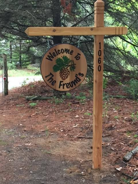 Hanging family sign with 4x4 posts, carved ends and address.
