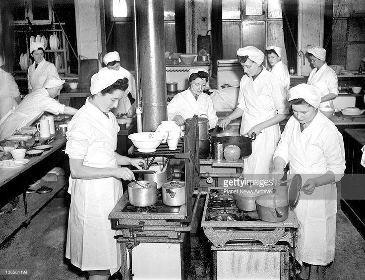 In the kitchen at the National Training College of Domestic Subjects, Buckingham Palace Road, London, ATS girls who are on a five week course in Domestic Science cook a meal. (L-R) Subaltern Gwendoline Alkin, of Swindon, Wiltshire, Cpl. Cathering Ross, of Huntley, Aberdeen, Scotland, Subaltern Betty Davies, of Crowborough, Sussex, and Private Muriel Diggins, of Whitton, Middlesex.