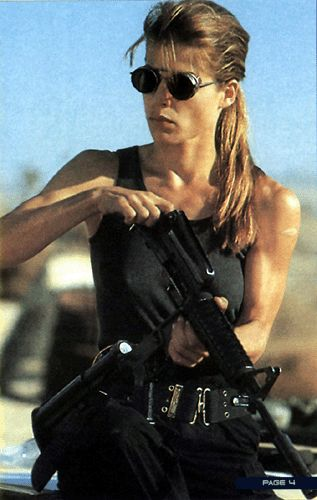 Linda Hamilton as Sarah Connor  in The Terminator. Best physique for a woman award - she's got such great guns she doesn't really need the rifle...