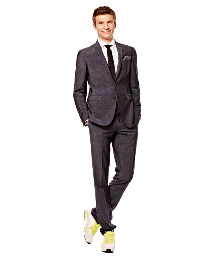 Thomas Müller wearing a suit with trainers