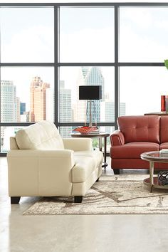 A loveseat creates ample room for one or the perfect spot for two. The genuine leather Landon Loveseat is genuinely eye-catching in its rich shade of bone.