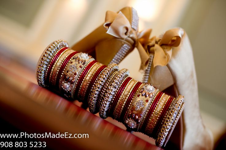 Bride's Shoes, accessories, ring, boquet, chura, clutch, necklace, jewellery jhumka, kalira, payel, bridal makeup, bridal wear earrings, garter, mangalsutra, pagri, groom's turban, groom's cufflink, groom's watch, tika, wedding jewellery,bridal jewellery - Photo by PhotosMadeEz