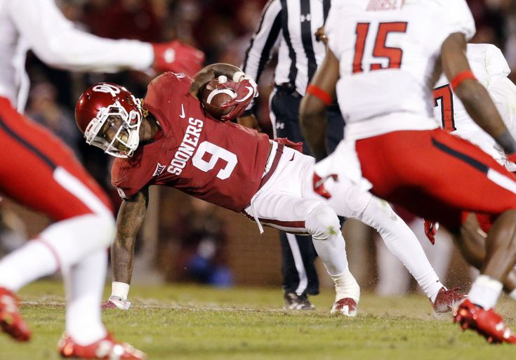 CeeDee Lamb tries to keep his balance on a run after a catch during the second half of a college football game in which the University of Oklahoma Sooners (OU) defeated the Texas Tech Red Raiders 49-27 at Gaylord Family-Oklahoma Memorial Stadium in Norman, Okla., on Saturday, Oct. 28, 2017. Photo by Steve Sisney, The Oklahoman