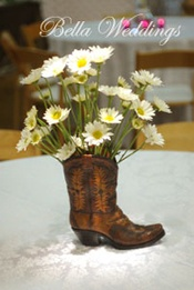 cowboy boot centerpiece - www.bellaweddingrentals.com