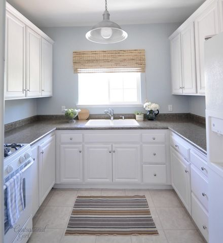 After kitchen cabinets.  Used Rustoleum Cabinet Transformations - no stripping method of refinishing cabinets