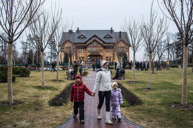 People wander around President Viktor Yanukovych's Mezhyhirya estate, which was abandoned by security, on Feb. 22, 2014 in Kiev, Ukraine.
