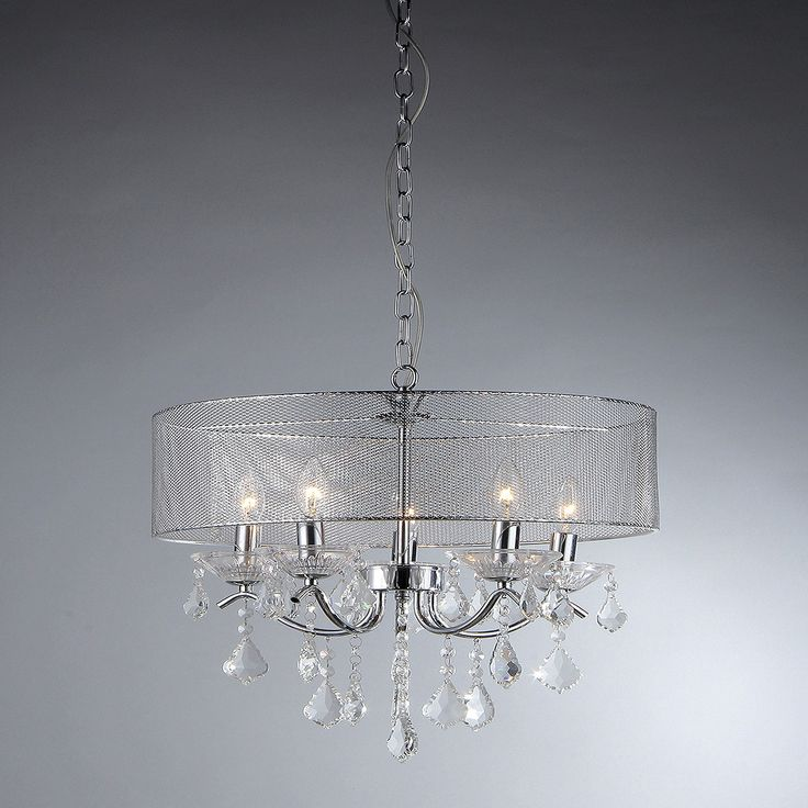 Raw, industrial design meets glamorous sparkle in this Warehouse Of Tiffany Chandelier Ceiling Lights – Silver. Combining chrome construction with beautiful crystals, this eye-catching light gives off a soft glow with unique style. The metal mesh drum-shaped lamp shade offers a peek into the five-bulb center while swags of crystals shine below. Hang this ceiling light over your dining table or in your entryway for a show-stopping look.