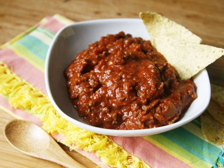 Slow Cooker Beanless Chili Whether spooned over hot dogs, tucked into a burrito or enjoyed in a bowl by itself, there are endless possibilities for serving this chili! #gameday #recipes