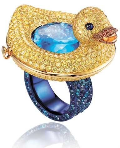 Duckie ring by Chopard. The ring is made of 18k yellow and is covered with stones: yellow diamonds (10.96 carats), amethysts, Paraiba tourmalines (2.30 carats), blue and orange sapphires, topazes (15.09 carats), lazulites (1.14 carats), and blue cabochon sapphires. Via @Becky C of Diamonds in the Library