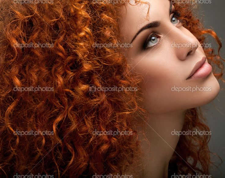 Red Hair. Beautiful Woman with Curly Long Hair and Sunglases ...