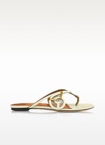 €258.00 | June Ivory Leather Thong Flat Sandal w/Rattan Detail is a vintage rattan furniture inspired shoe that takes you through the urban jungle in glamorous style. Featuring thong design with swirl side detail and mesh inserts, rattan accents and leather sole. Signature box and dust bag included. Made in Italy.