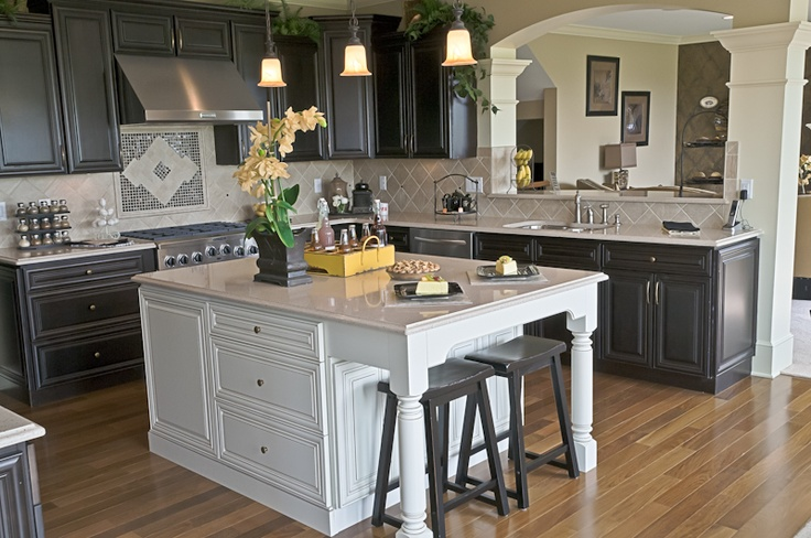 Dark Cabinets With A White Accent Island And A Back Splash
