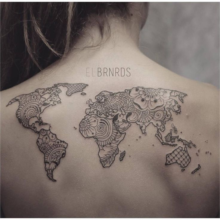 Ornamental style world map on the upper back. Tattoo artist: Elda Bernardes (Tattoo Travel Ideas)