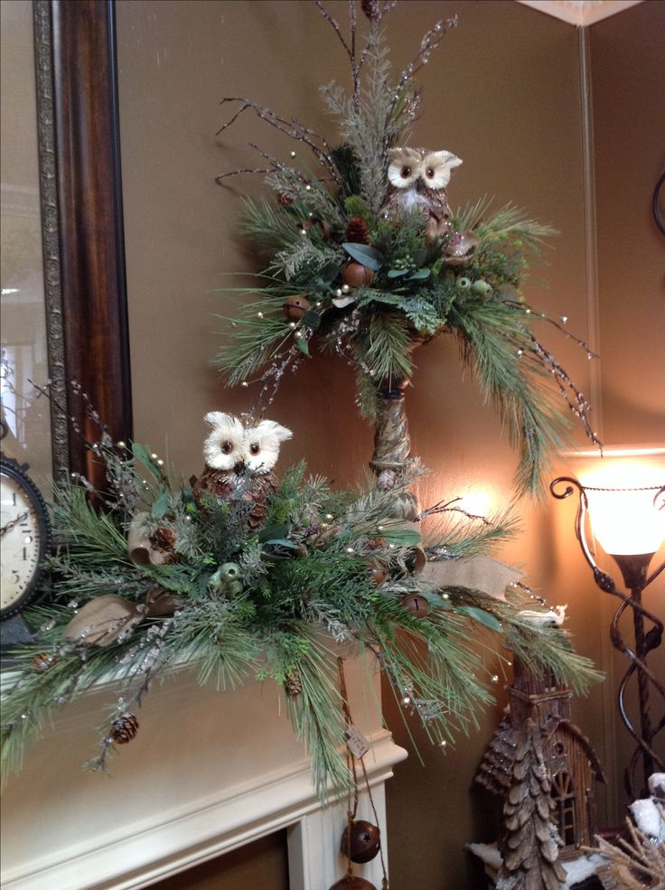 Owl floral arrangements on mantel in burlap room. Great decorating idea from Christmas through Winter.
