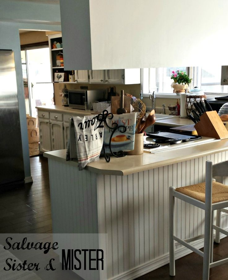 A kitchen budget makeover. Painted cabinets and more low cost touches to turn this kitchen around.  Bright and cheerful now.  www.salvagesisterandmister.com